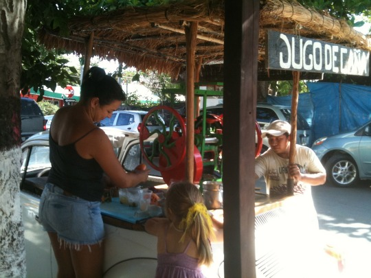 Our sugar cane juice stop on the way home from school.